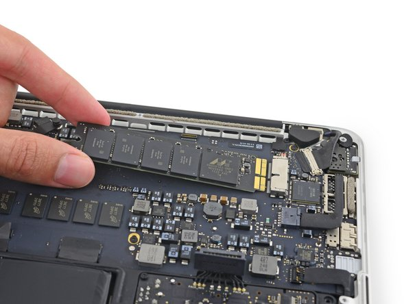 "Only lift the end of the SSD enough to allow you to pull it out—about 1/4""."