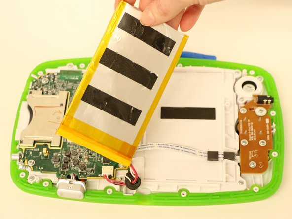The battery is held in place by an adhesive strip, so it can be difficult to pry off.