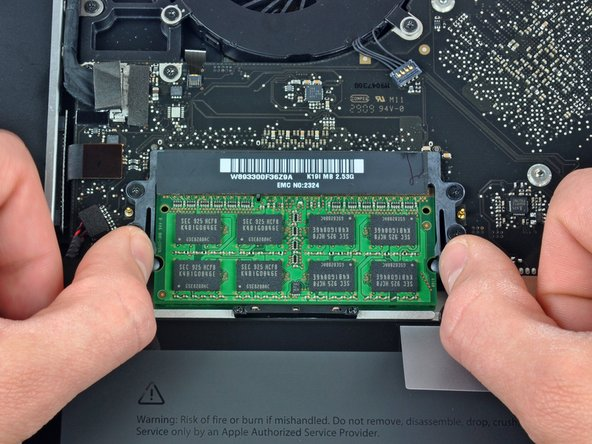 "Image 1/2: These tabs lock the chip in place and releasing them will cause the chip to ""pop"" up."