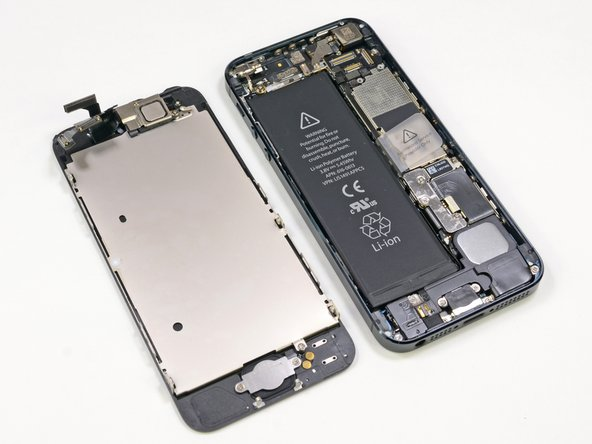Image 1/2: The iPhone 5 ditches its lid to show us all of the juicy bits inside.