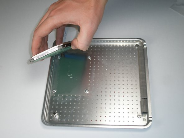 Image 1/1: The hard drive is held on to the lower case with mild adhesive.