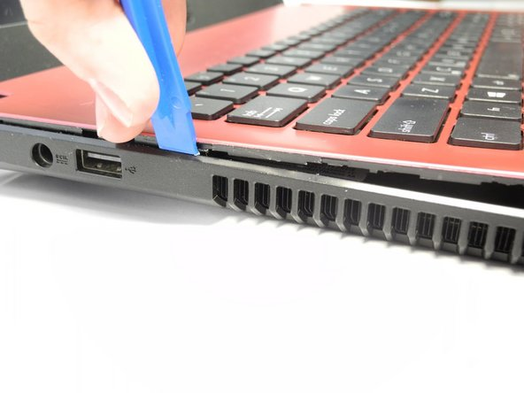 Flip the laptop back over and begin prying the keyboard cover from the rest of the  laptop by using a plastic spudger.
