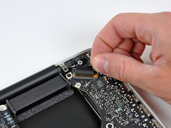 Pull the display data cable straight out of its socket.