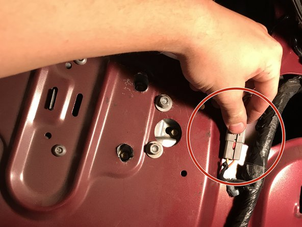 Disconnect the power cord attached to the window motor.