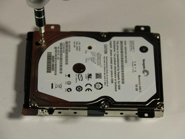 To remove the metal hard drive casing, use a T6 (star head) screwdriver head to remove six 4mm screws marked by the red circles in the picture.