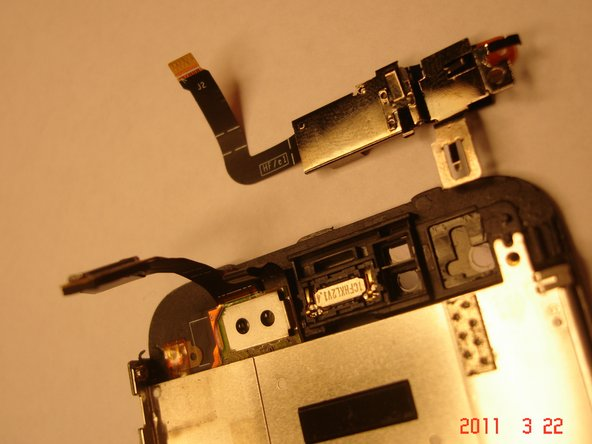 Once the bracket is loose, you can pull it up carefully maneuvering it up and around the LCD and digitizer connectors.