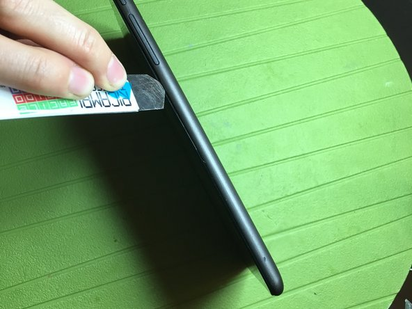 With a thin opening tool remove the back cover prying between screen and cover on all the device edges.