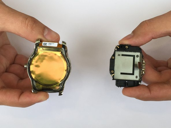 Carefully pinch out the battery case with your fingers to remove it from the face of the watch.