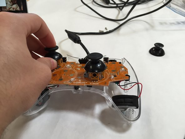 If you have purchased the wrong style of thumbstick, superglue, hot glue, or any other adhesive should work fine. Simply use a needle to put some adhesive and/or glue into the hole.