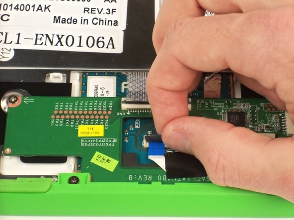 Image 1/1: Slide out the blue ribbon cable.