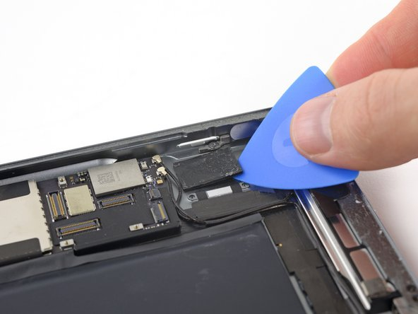 The SIM board is held to the rear case with a thick adhesive pad.