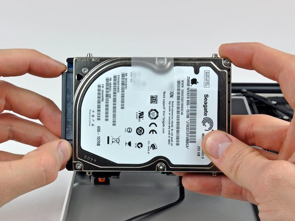 Remove the hard drive from its cable by pulling the cable connector straight away from the drive.