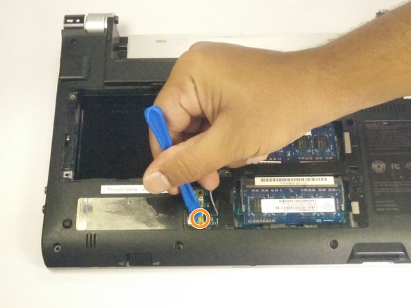 Image 3/3: Use the plastic opening tool to pry up the two connectors.
