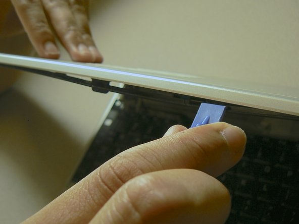 Use a plastic opening tool to separate the screen bezel from the rest of the case.