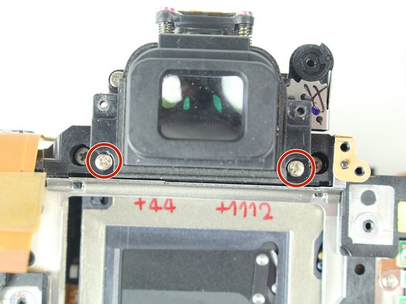 Image 1/3: Remove the viewfinder cover.