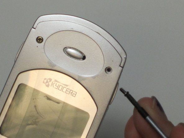 Remove the four tiny front screen screws with a screw driver