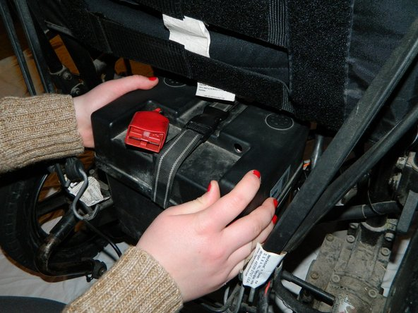 Place the first battery back into the holder under the wheelchair.