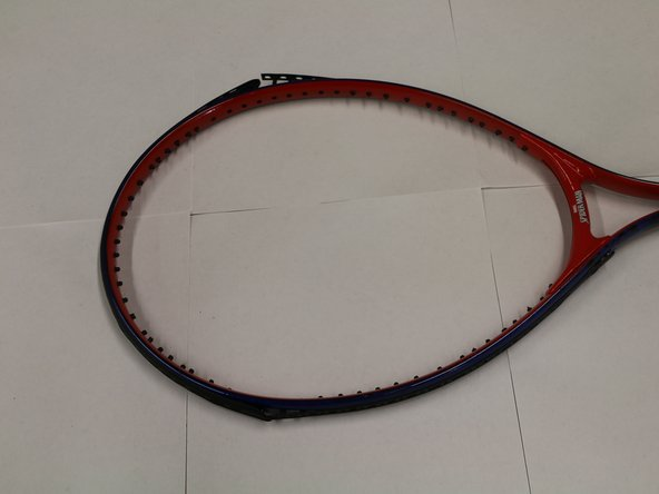 This is how the tennis racket will look like when all of the strings are removed.