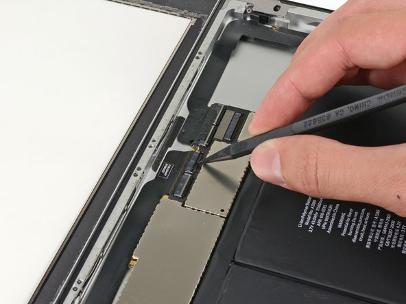 Image 2/3: Flip up the retaining flap on both of the digitizer ribbon cable ZIF connectors.