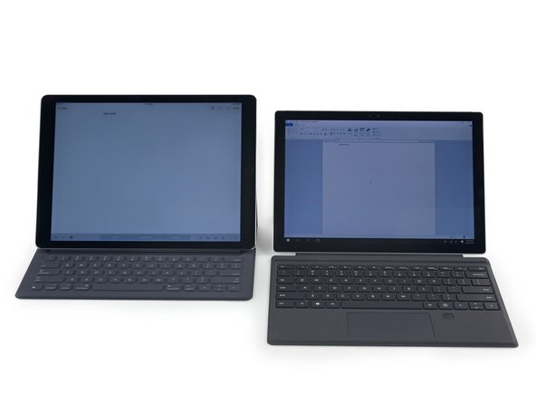 On the left, an iPad Pro with the Smart Keyboard. On the right, a Surface Pro 4. We're pretty sure anyway, the differences are pretty slight at first glance.