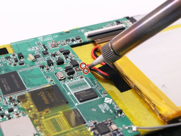 Use a soldering tool and tweezers to remove the black and red wire from the motherboard.