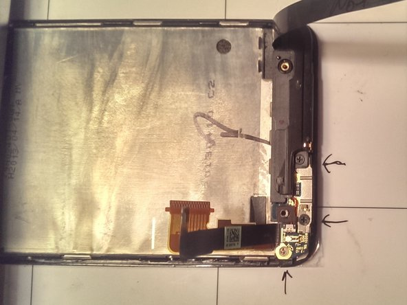 First transfer the earpiece, power button, and spacer onto the new screen assembly