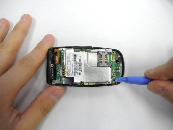 Use a spudger to lift the logic board and separate it from the main body of the phone.