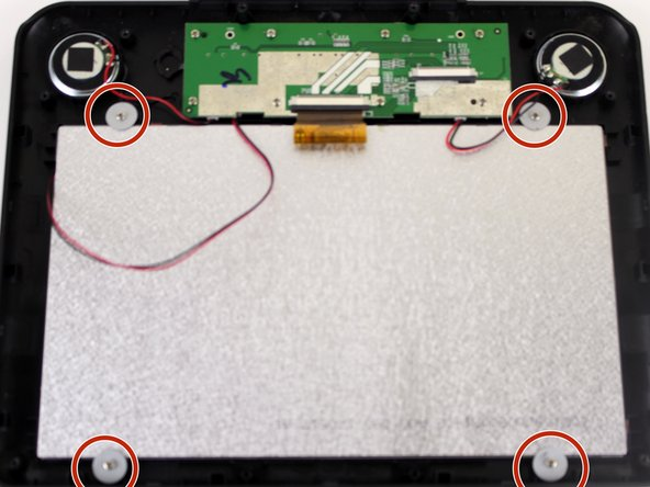 Unscrew the corners of screen with the JIS #000 screwdriver. There are four,  6 mm screws with washers.