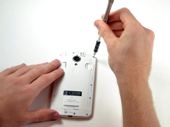 Using the same screwdriver, remove the six 3.2 mm screws on the sides.