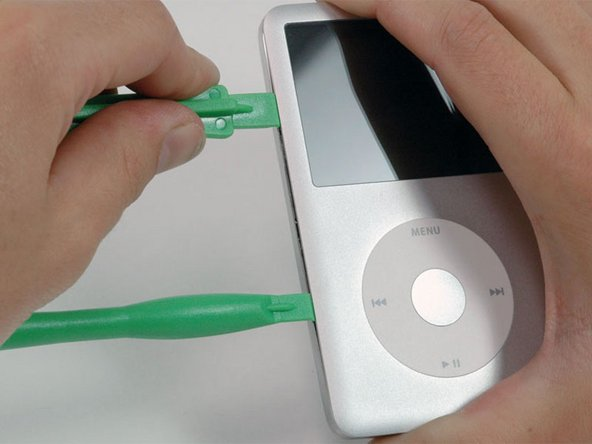 Image 1/1: Insert another plastic opening tool into the seam between the front and back of the iPod, leaving at least 1.5 inches of space between the two tools.