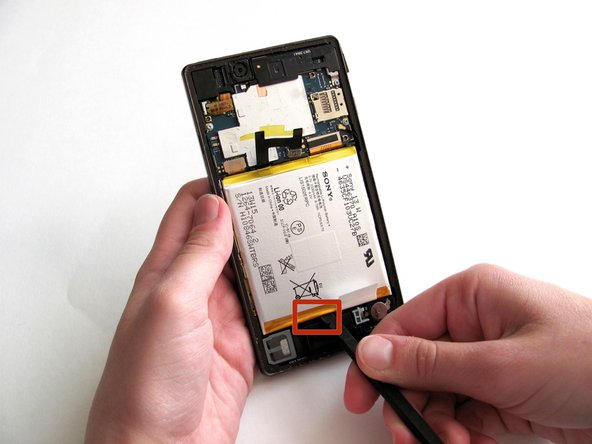Flex cables run vertically down the phone underneath the battery and can be damaged easily. Make sure to only place the spudger in the indicated area.