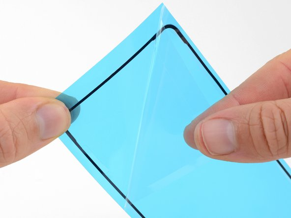 Peel the clear backing off of the replacement adhesive.