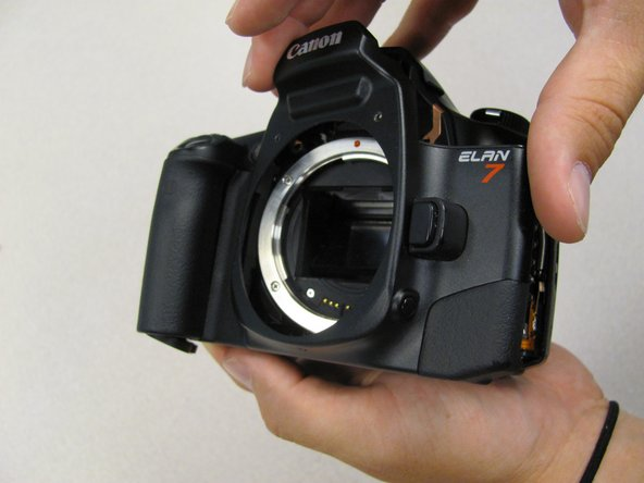 Remove the front panel by lifting it away from the camera's body.