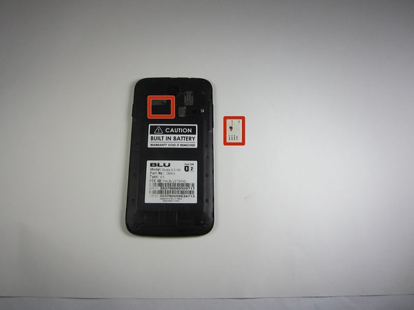 Image 2/3: Take the front end tip of the SIM card (the side with the corner cut) and slide it gently into the SIM card slot.
