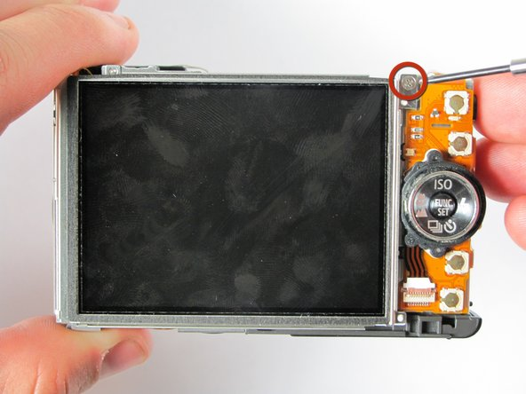 Turn the camera forward so that the LCD screen is facing you.