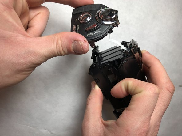 Take the back case off by pulling it away from the main body.