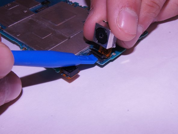 Disconnect the camera from the motherboard using a spudger.