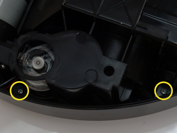 There are two screws on the sides of each wheel, one above and one below.