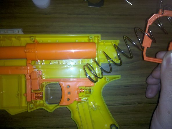 Carefully remove the plastic trigger catch and stock spring.