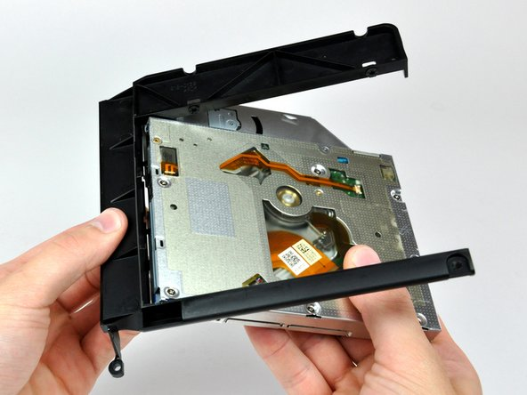 Rotate the optical drive bracket slightly away from the optical drive.