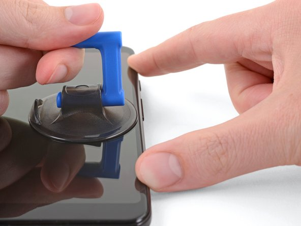 Pull up on the suction cup with a strong, steady force to create a gap between the screen and the phone.