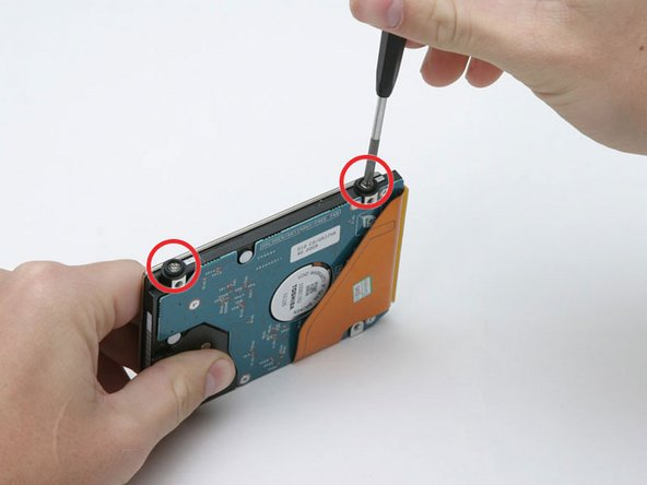 Image 1/1: Lift the metal bracket off of the hard drive.