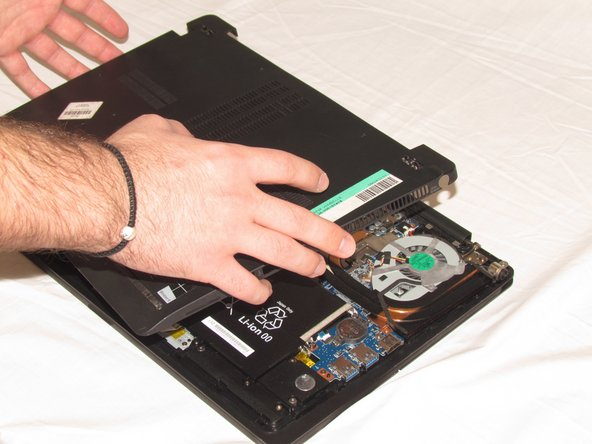 Lift the lower cover and pull away from the laptop.