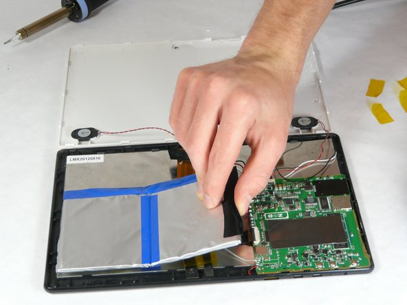 Carefully remove battery without putting any strain on connected wires. The battery is held to the tablet with adhesive, so be careful not to jerk the battery when it becomes loose.