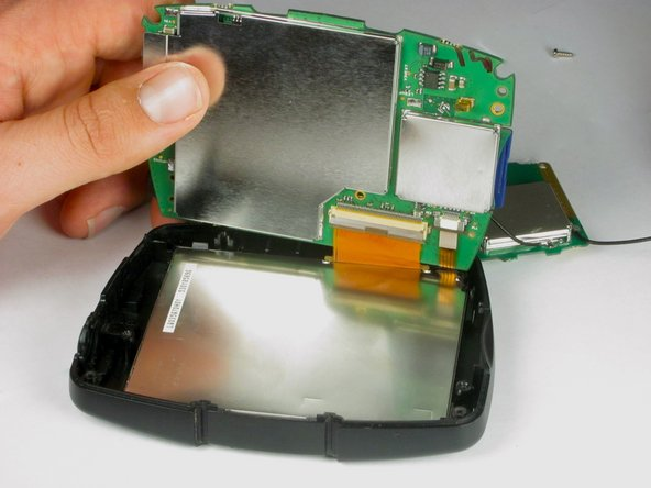 Image 1/1: Do '''not''' remove the motherboard yet, as it is stil attached to the LCD.