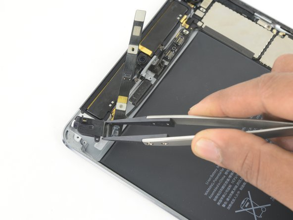 Remove the headphone jack from the iPad.