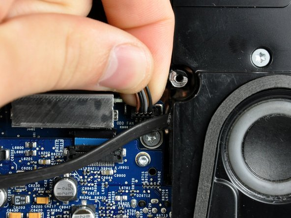 Disconnect the optical drive fan cable connector by pulling it straight up off its socket on the logic board.