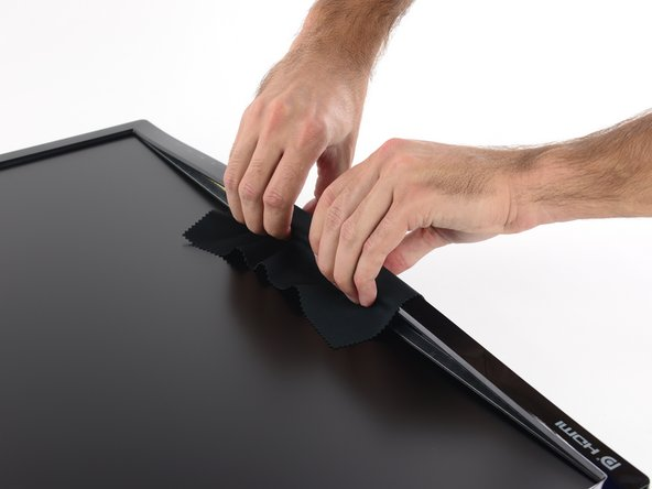 Rather than use any prying tools that could damage the LCD, it's best to just pull with your fingers. A thin cloth will both protect your fingertips and prevent you from smudging the LCD.