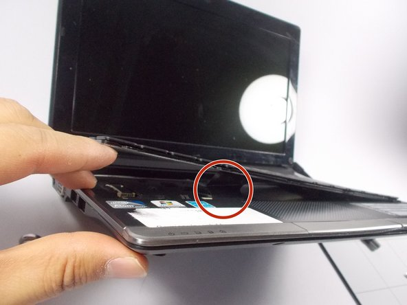 Do not attempt to remove the keyboard. It is still attached to the laptop by a ribbon cable.