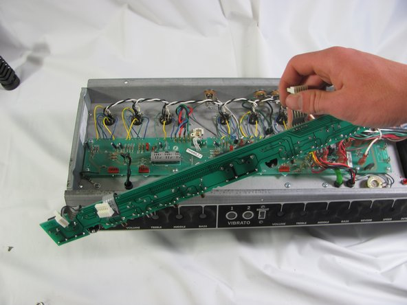 Locate the three pin connecters between the two PCBS. Gently unplug them by pulling straight up.